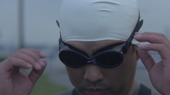 Slow motion of swimmer removing goggles Stock Footage