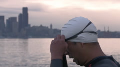 Swimmer with Seattle Sunrise Background Stock Footage