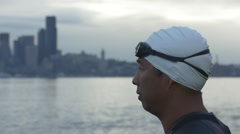 Swimmer removes goggles in Seattle. Stock Footage