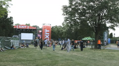 Concert crowd  on music festival, on day grass field Stock Footage