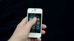 Facebook Login page on a white iPhone display Stock Footage