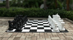 Giant Chess Set Game Outside Ready for Fun in the Summer Sun, HD Stock Footage