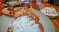 4k UHD time lapse video on eating Peri-Peri chicken, rice, coleslaw Stock Footage