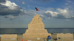 Marine Corp sand sculpture US flag Stock Footage