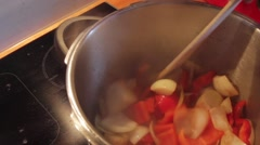 Agitate onions and red pepper Stock Footage