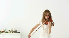 Caucasian violinist girl on a white background. Medium shot. Stock Footage