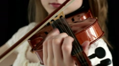 Caucasian violinist girl on a black background. Closeup. Stock Footage
