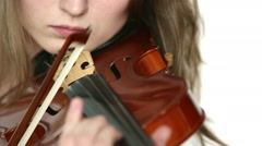 Caucasian violinist girl on a white background. Closeup. Stock Footage