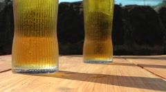 Stock Video Footage of 2 pint glasses summer day, british pub culture