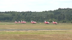 9 Red Arrows Hawk Aircraft Taxi in formation Stock Footage