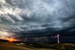 Thunder Storm aproaching ancient landscape Transylvania . Cottage smoke Kuvituskuvat