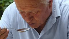 panning on old man eating soup: 4k  close up panning on retired man - stock footage
