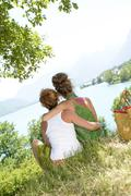 Two lesbians in nature admire the landscape Stock Photos