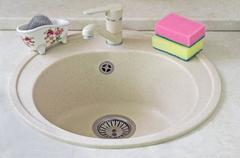 Sink for ware from metal ceramics and a sponge for washing. Stock Photos