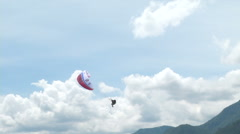 Acrobatic paragliding synchro white red 27 (slow motion) Stock Footage