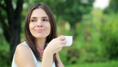 Businesswoman having coffee break by the table in garden HD Stock Footage