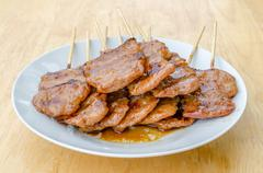 Thai style bbq grilled pork or moo-ping Stock Photos
