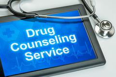 Tablet with the text drug counseling service on the display Stock Photos