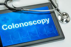 Tablet with the text colonoscopy on the display Stock Photos