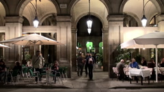 Tourists at the Royal Plaza at night. Barcelona, Catalonia, Spain. Stock Footage