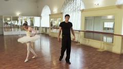 Man and woman rehearse ballet moves, take break from dancing Stock Footage