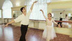 Beautiful couple performing ballet moves together, pas de deux Stock Footage