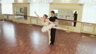 Couple practicing ballet dancing in front of mirrors, slow-mo Stock Footage
