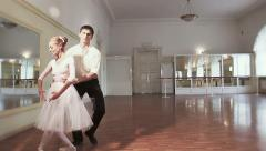 Pas de deux, female male ballet dancers taking steps together Stock Footage