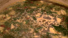 Close up of clams and broth being stirred Stock Footage