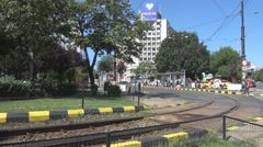 Old tram changing travel direction, and stopping in station, clear sunny day out Stock Footage