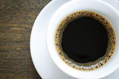 Coffee in white cup on wood table Stock Photos