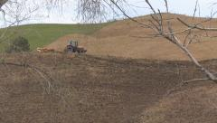 Framed view of field ploughing Stock Footage