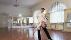 Ballet dancing, young male dancer twirling ballerina around, click for HD Stock Footage