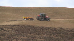 A pan view of tractor ploughing a hillside Stock Footage