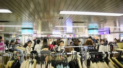 Women buying clothes inside Ikebukuru Station in Tokyo, Japan Stock Footage