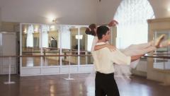 Pas de deux in slow motion, couple dancing classical ballet, click for HD Stock Footage
