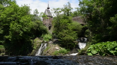 Waterfall of Elz river with small church Stock Footage