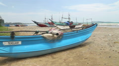 Close up of wooden fishing boats and nets on beach in Weligama. Stock Footage