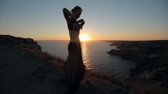 Stock Video Footage of Stunner girl dancing oriental dance at sunset