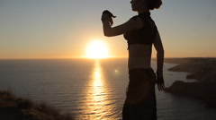 Magnificent girl dancing oriental dance at sunset Stock Footage