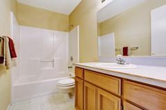 Empty bathroom interior in soft ivory Stock Photos