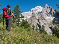 Stock Photo of hiker admiring mountain landscape