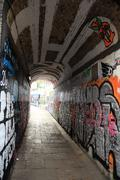 graffiti on tunnel in alley - stock photo