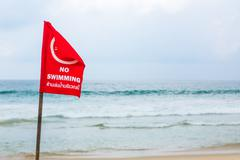 no swimming danger sign at the beach - stock photo