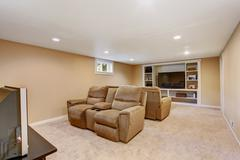 Home theater interior in soft brown color Stock Photos