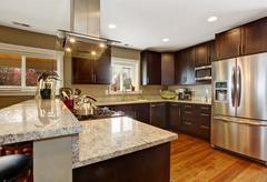 dark brown kitchen room with steel appliances - stock photo
