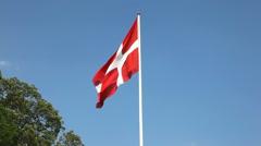 Danish flag agains a blue sky Stock Footage