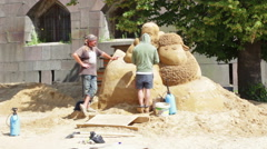 Creating sand sculptures near the walls Fortress in St. Petersburg Stock Footage