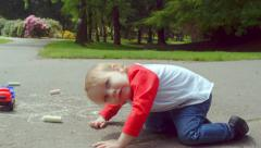 Little Boy Is Curious About Camera, Turns His Body Sideways To Get A Better Look - stock footage