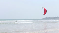 Kitesurfer jumping in the waves and surf in Weligama, Sri Lanka. Stock Footage